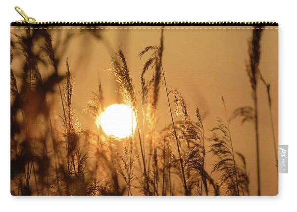 View Of Sun Setting Behind Long Grass B Carry-all Pouch