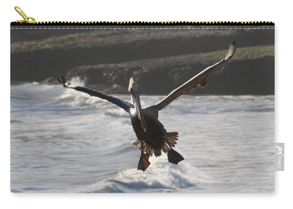 Carry-all Pouch featuring the photograph Wacky Pelican In Flight by Christy Pooschke