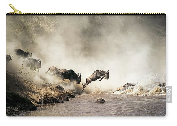 Wildebeest Leaping In Mid-air Over Mara River Carry-all Pouch