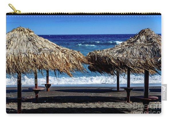 Wood Thatch Umbrellas On Black Sand Beach, Perissa Beach, In Santorini, Greece Carry-all Pouch