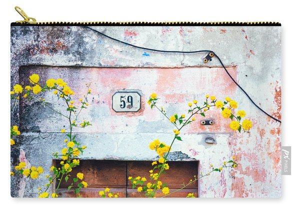 Yellow Flowers And Decayed Wall Carry-all Pouch