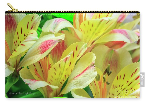 Carry-all Pouch featuring the photograph Yellow Peruvian Lilies In Bloom by Richard J Thompson