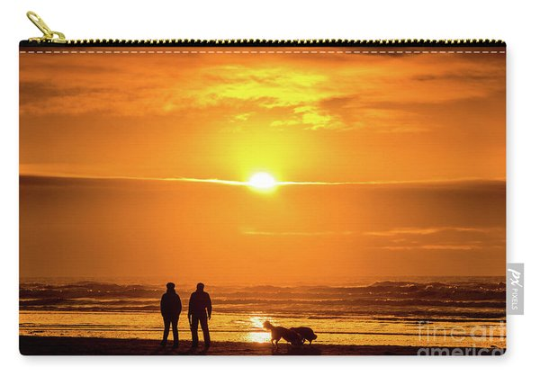 A Couple Walking Their Dog At Sunset On Ynyslas Beach, Wales Uk Carry-all Pouch