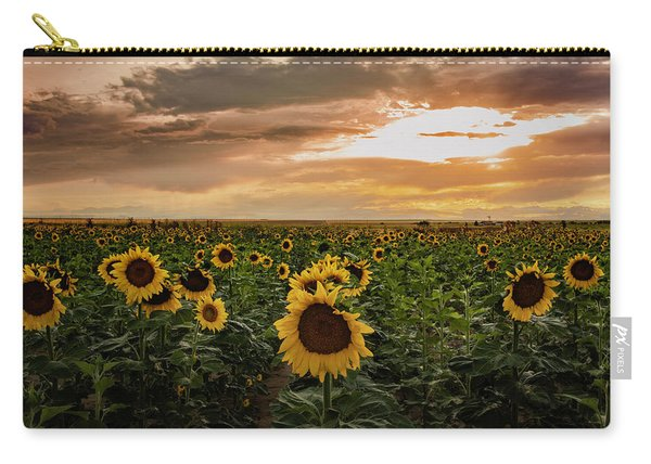 A Field Of Sunflowers At Sunset Carry-all Pouch