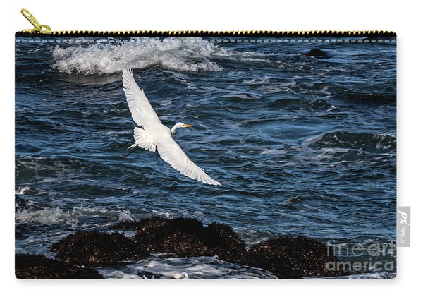 A Great Egret Soars Over Waves Carry-all Pouch