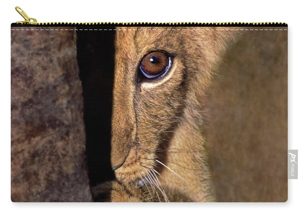 A Lion Cub Plays Hide And Seek Wildlife Rescue Carry-all Pouch