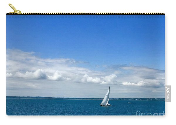 A Single Sailboat In Blue Carry-all Pouch