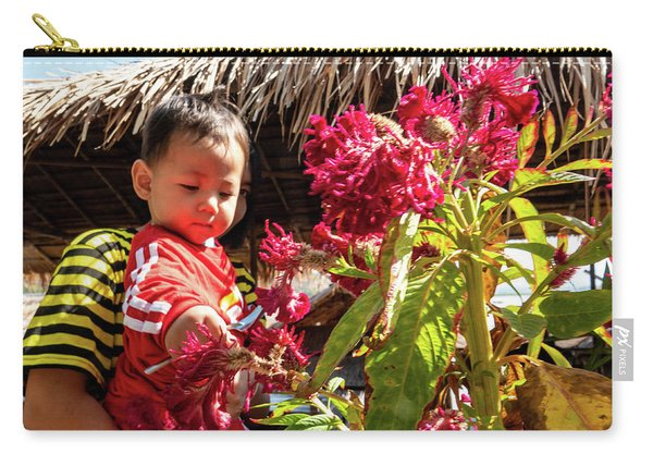 A Small Person With Reflected Flowers Carry-all Pouch