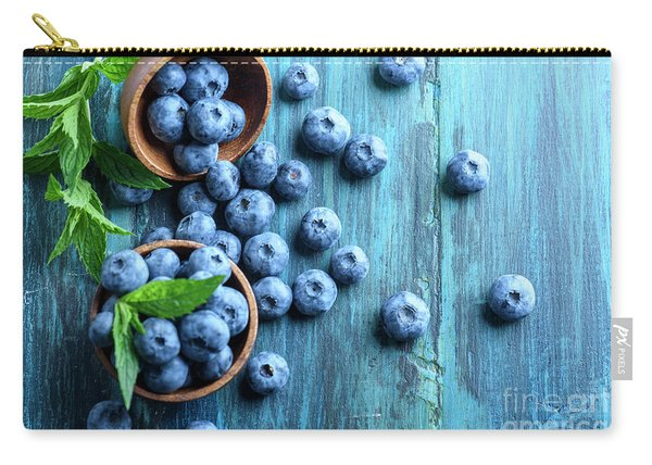 Bowl Of Fresh Blueberries On Blue Rustic Wooden Table From Above Carry-all Pouch