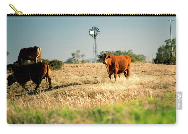 Carry-all Pouch featuring the photograph Cows And A Windmill In The Countryside. by Rob D Imagery