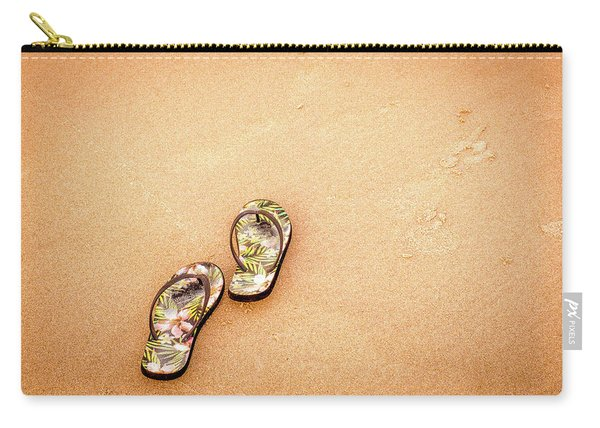 Carry-all Pouch featuring the photograph Flip-flops On The Sand. by Jeff Sinon