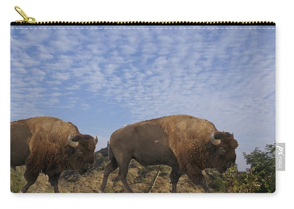 Group Of Bison Walking Against Rocky Mountains  Carry-all Pouch