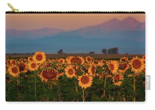 Carry-all Pouch featuring the photograph Light Of The Sunflowers by John De Bord