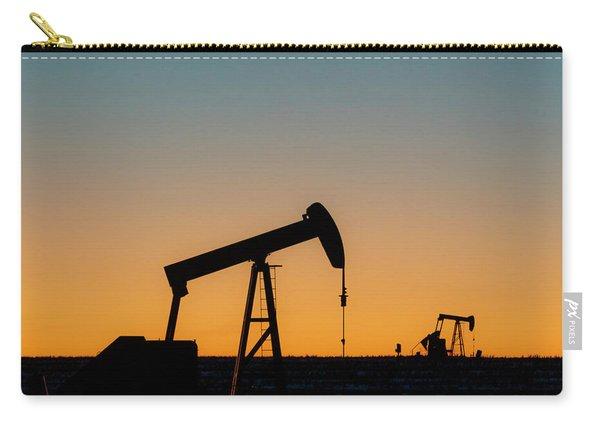 Carry-all Pouch featuring the photograph Oil Pumps After Sunset 01 by Rob Graham