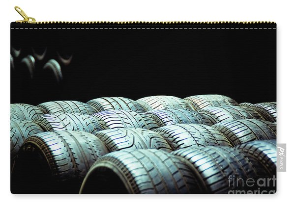 Old Tires And Racing Wheels Stacked In The Sun Carry-all Pouch