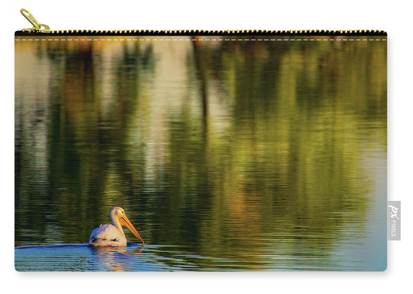 Carry-all Pouch featuring the photograph Pelican In Sunlight by John De Bord