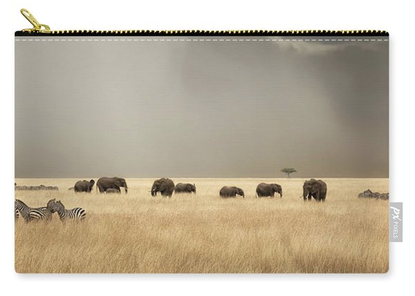 Stormy Skies Over The Masai Mara With Elephants And Zebras Carry-all Pouch