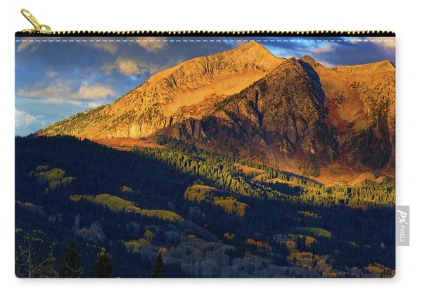 Carry-all Pouch featuring the photograph Sunlight Along The Mountain by John De Bord
