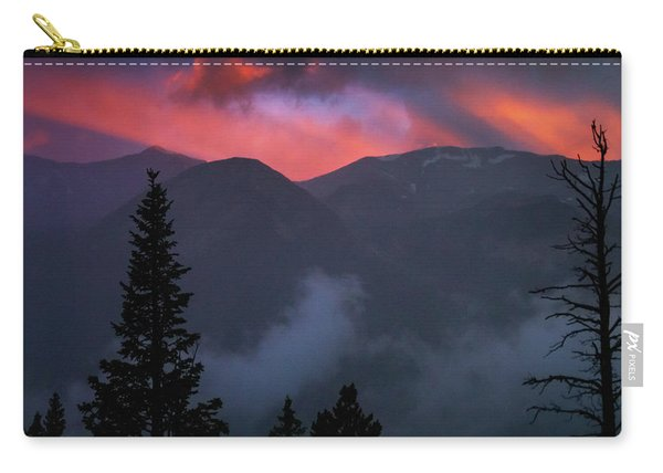 Carry-all Pouch featuring the photograph Sunset Storms Over The Rockies by John De Bord