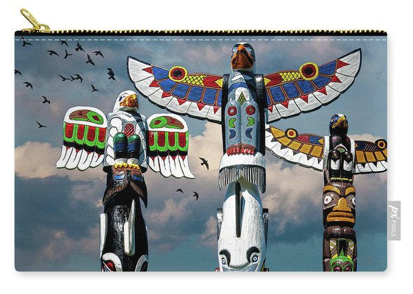 Totem Poles Against A Cloudy Sky With Flying Birds Carry-all Pouch