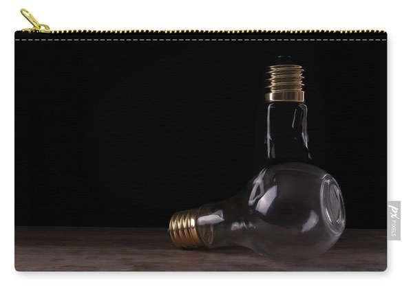 Two Light Bulbs Arranged On A Wooden Table  Carry-all Pouch