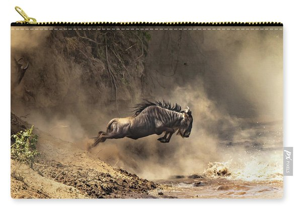 Wildebeest Leaps From The Bank Of The Mara River Carry-all Pouch