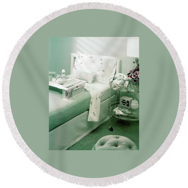 A Green Bedroom With A Breakfast Tray On The Bed Round Beach Towel