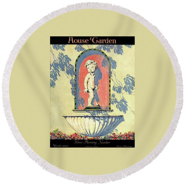 A House And Garden Cover Of A Statue Of A Boy Round Beach Towel