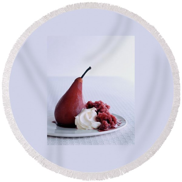 A Poached Pear With Cream Round Beach Towel