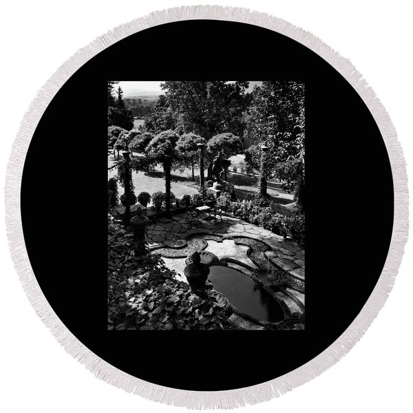 A Pond In An Ornamental Garden Round Beach Towel