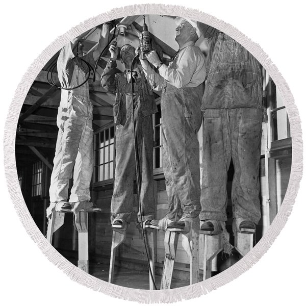 Electricians On Stilts Round Beach Towel