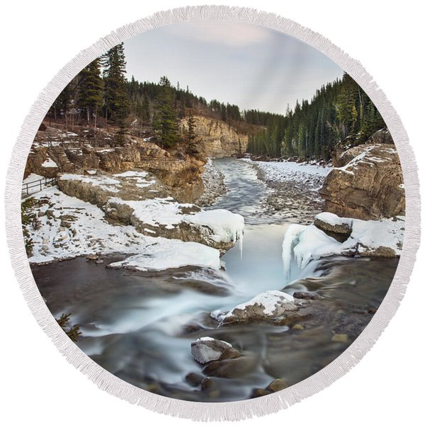 In The Frosty Forests Round Beach Towel