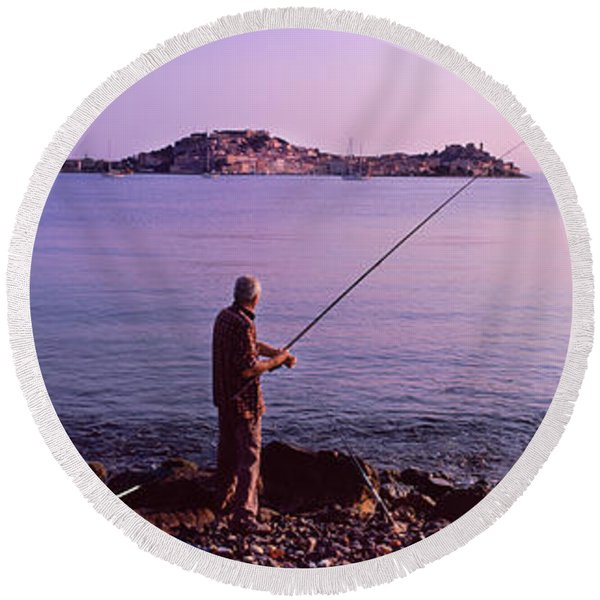 Man Fishing At The Coast, Portoferraio Round Beach Towel