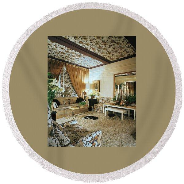 The Living Room Of Leoda De Mar's Home Round Beach Towel