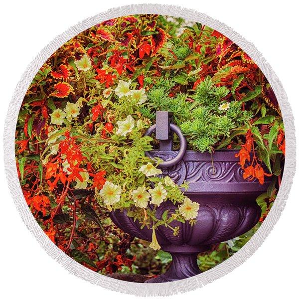 Round Beach Towel featuring the photograph Decorative Flower Vase In Garden by Ariadna De Raadt