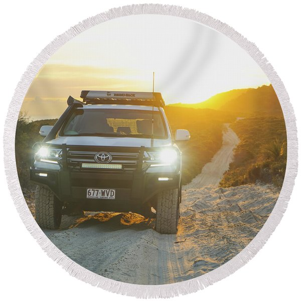 4wd Car Explores Sand Track In Early Morning Light Round Beach Towel