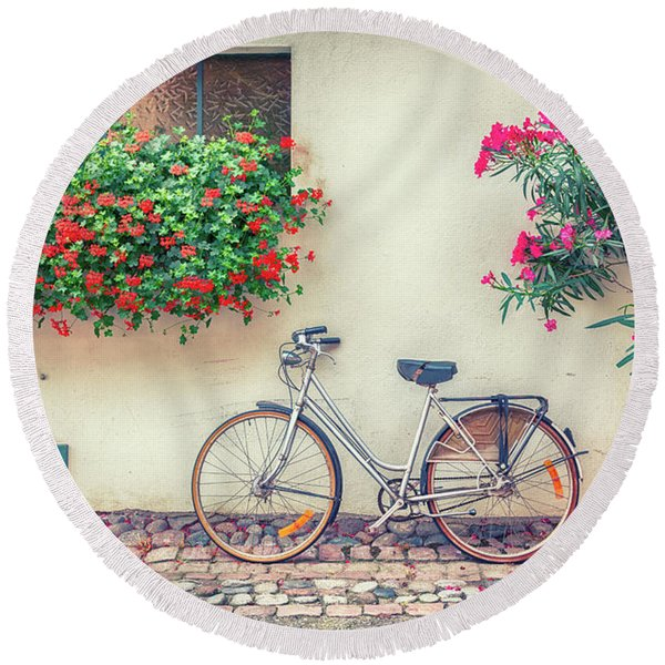 Round Beach Towel featuring the photograph bike in France village  by Ariadna De Raadt