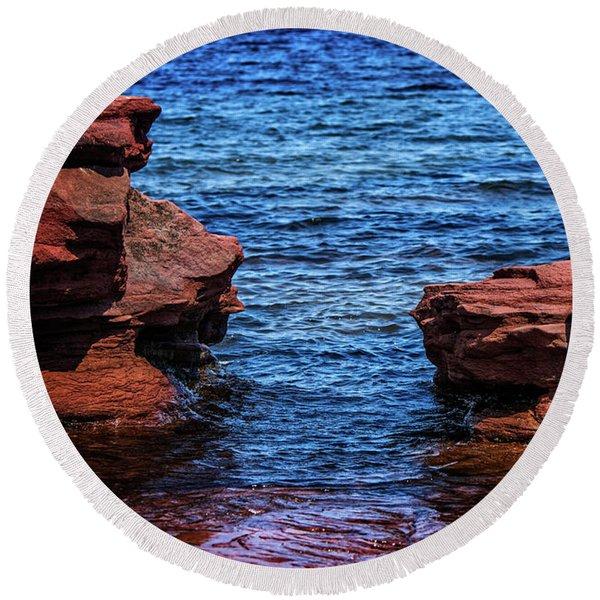 Blue Water Between Red Stone Round Beach Towel