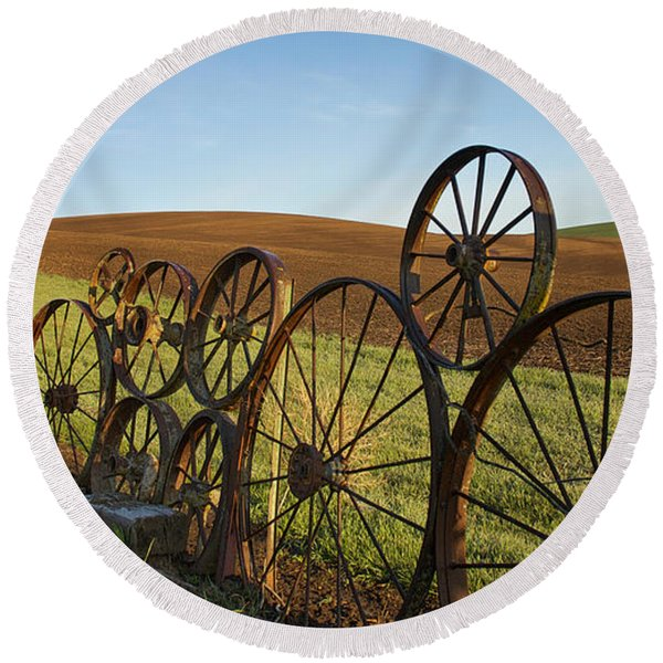 Round Beach Towel featuring the photograph Fence Of Wheels by Mary Lee Dereske