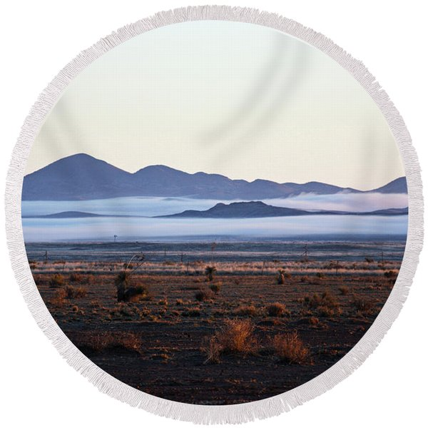 Round Beach Towel featuring the photograph Fog In The Peloncillo Mountains by Lon Dittrick