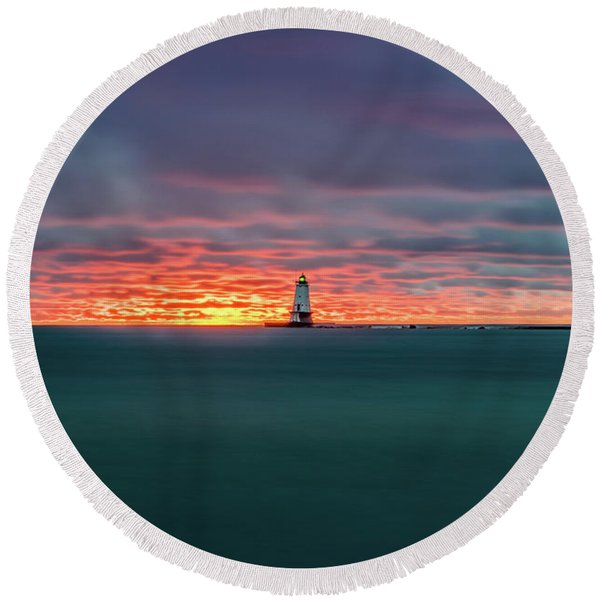 Glowing Sunset On Lake With Lighthouse Round Beach Towel