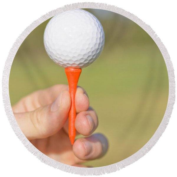 Hand Holding Golf Ball And Tee Round Beach Towel