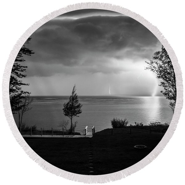 Round Beach Towel featuring the photograph Lightning On Lake Michigan At Night In Bw by Mary Lee Dereske
