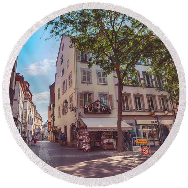 Round Beach Towel featuring the photograph morning in Colmar, old medieval town in Alsace region in France by Ariadna De Raadt