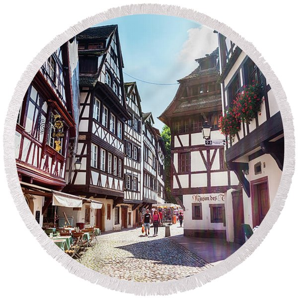 Round Beach Towel featuring the photograph street of Petit-France - part of old town, Strasbourg,  France,  by Ariadna De Raadt