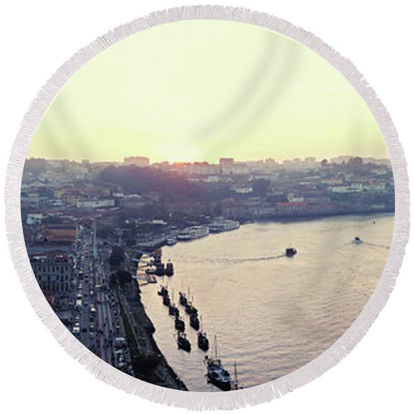 Round Beach Towel featuring the photograph sunset panorama of the Douro river in Porto, Portugal by Ariadna De Raadt