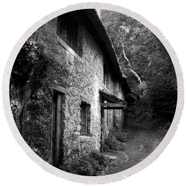 Round Beach Towel featuring the photograph The Game Keepers Cottage by Michael Hope