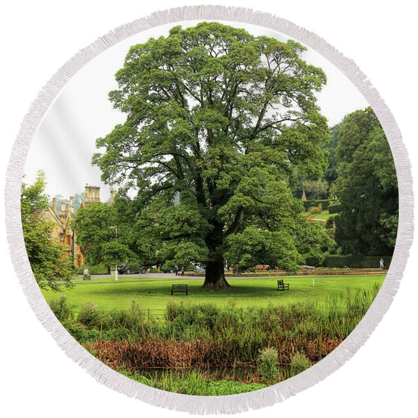 Round Beach Towel featuring the photograph The Manor Castle Combe by Michael Hope