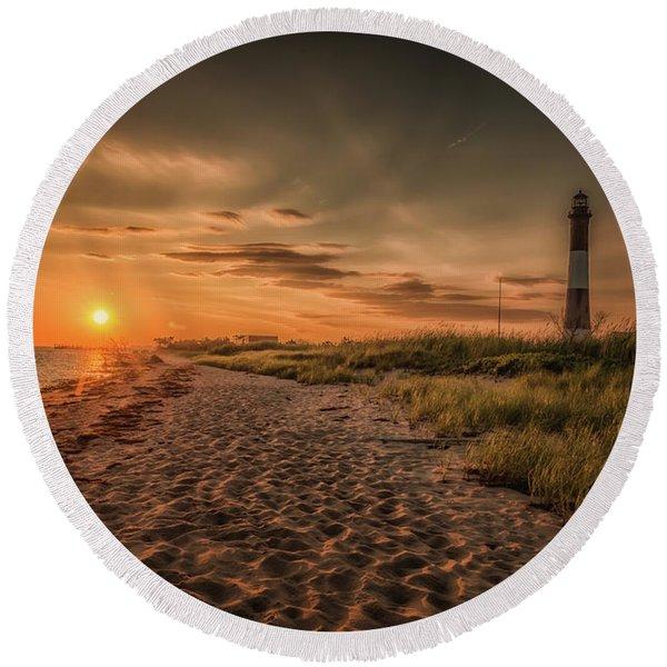 Warm Sunrise At The Fire Island Lighthouse Round Beach Towel