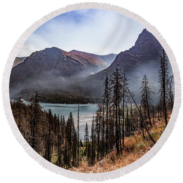 Round Beach Towel featuring the photograph Wildfire Remnants Overlooking St. Mary's Lake, Glacier National Park by Lon Dittrick